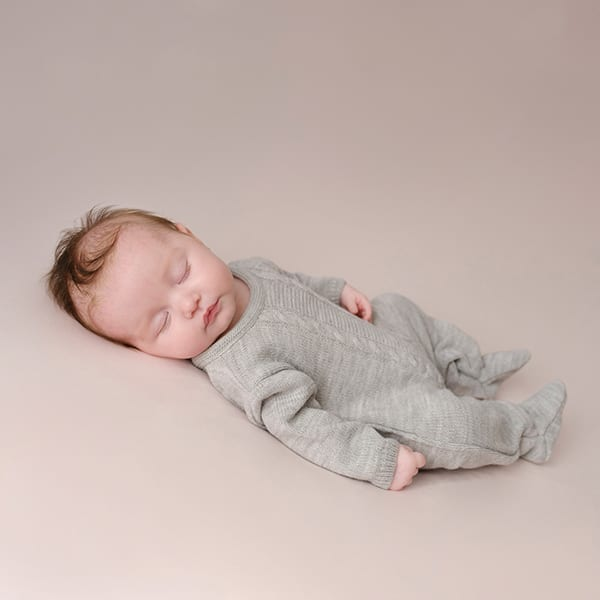 Grey cable knitted newborn onesie Spilsby